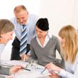Business team meeting around table — Stock Photo