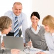 Business team meeting around table - Stock Photo