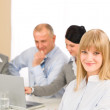 Businesswoman at team meeting with colleagues — Stock Photo #9036698