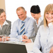 Businesswoman at team meeting with colleagues — Stockfoto