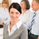 Young executive woman look camera during meeting — Stock Photo