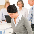 Stockfoto: Young executive woman take notes during meeting