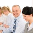 Smiling businessman during team meeting — Stock Photo #9036749