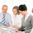 Businesswoman at team meeting with colleagues — Stock Photo #9036763