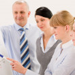 Business team standing in front of flip-chart — Stock Photo