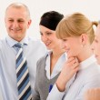 Business team standing in front of flip-chart — Stock Photo #9036798