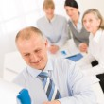 Giving presentation businessman point flip-chart — Stock Photo