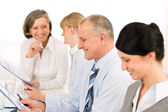 Smiling businessman during team meeting — Stock Photo