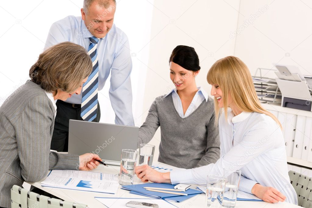 Business team meeting around table brainstorming in office  Stock Photo #9036672
