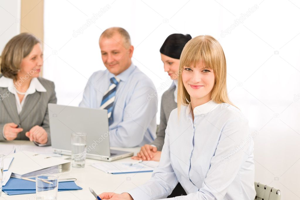 Businesswoman smiling at team meeting with colleagues — Stock Photo #9036691