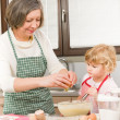 Grandmother and granddaughter baking cookies — Stock Photo #9547860