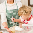 Grandmother and granddaughter baking cookies — Stock Photo #9547862