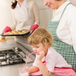 Three generations of women baking in kitchen — Stock Photo