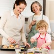 Family women baking cupcakes in kitchen — Stock Photo