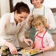 Family women baking cupcakes in kitchen — Stock Photo #9547910