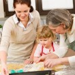 3 generations women prepare dough for baking — Stock Photo