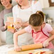 Mother and daughter making apple pie together — Stock Photo #9548010