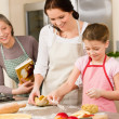 Mother and daughter prepare dough home cake — Stock Photo #9548012