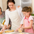 Three generation of women baking dough kitchen — Stock Photo #9548013