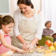 Mother and daughter making apple tart together — Stock Photo #9548031