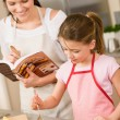 Royalty-Free Stock Photo: Mother and daughter make apple pie recipe