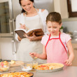 Mother and daughter make apple pie recipe — Stock Photo #9548055