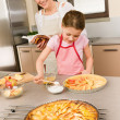Mother and daughter make apple pie recipe — Stock Photo