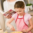 Young girl prepare apple pie with mother — Stock Photo #9548065
