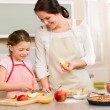 Mother and daughter cutting apples for pie — Stock Photo #9548080