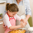 Decorating apple pie mother and daughter — Stock Photo #9548096