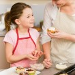 Daughter and mother decorating cupcakes sprinkles — Stock Photo