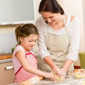 Mother and daughter prepare dough home cake — Stock Photo