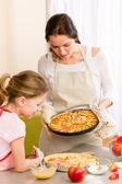 Apple pie mother and daughter baking — Stock Photo