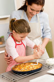 Decorating apple pie mother and daughter — Stock Photo