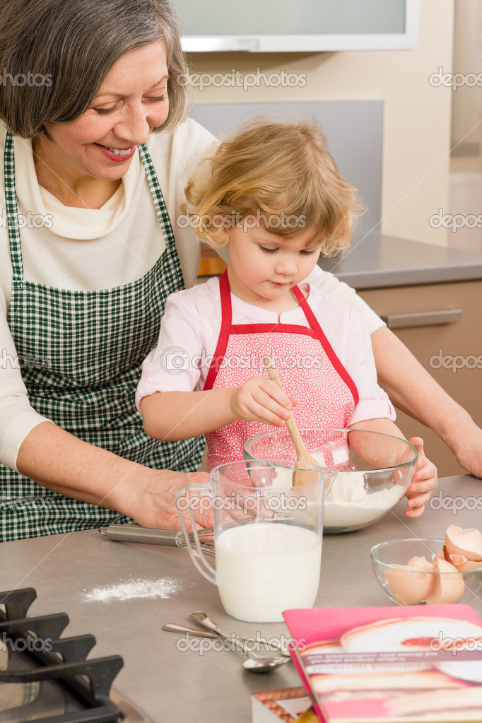 Child girl and grandmother baking cake stir flour — Foto de Stock   #9547840