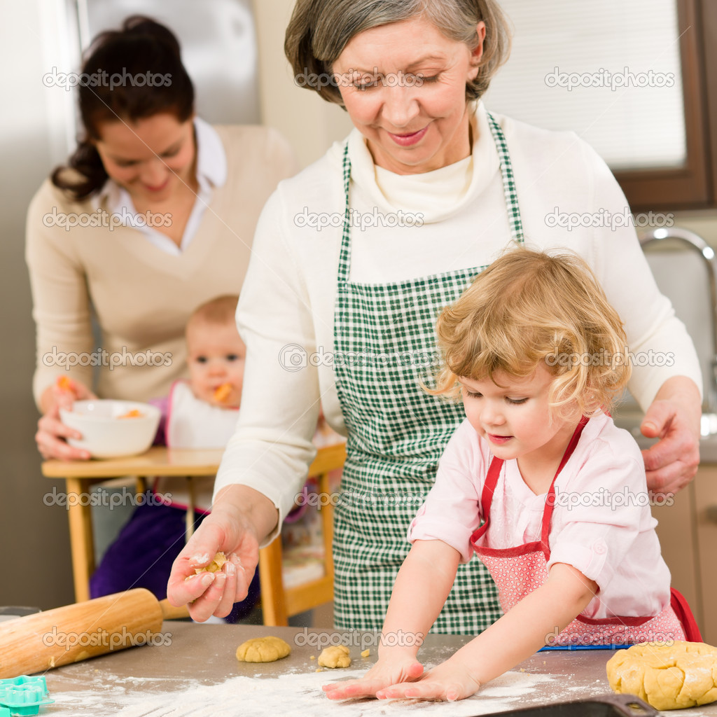 Grandmother with little girl prepare dough for baking in kitchen  Photo #9547971