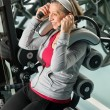 Fitness center senior woman exercise smiling - Stock Photo
