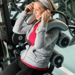 Stock Photo: Fitness center senior womexercise smiling