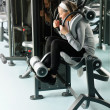 Fitness center senior woman exercise abs muscles - Lizenzfreies Foto