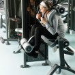 Fitness center senior woman exercise abs muscles - Stok fotoğraf