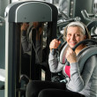 Fitness center senior woman exercise smiling - Stok fotoğraf