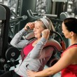 Stock Photo: Senior womexercise with personal trainer
