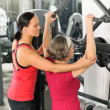 Senior womat fitness center exercise shoulder — Stockfoto #9624659