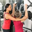 Senior woman at fitness center exercise shoulder — Stock Photo