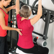 Stock Photo: Fitness center trainer senior womexercise back