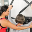 Fitness center trainer senior woman exercise back — Stock Photo #9624665