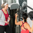 Personal trainer at fitness center showing exercise — Stock Photo
