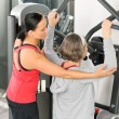 Stock Photo: Fitness center trainer senior woman exercise back