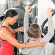 Fitness center trainer senior woman exercise shoulder — Stock Photo