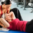 Senior woman exercise abdominal in fitness center — Stock Photo #9624697